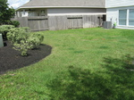 Easy Lawn Care of Houston, TX, will provide mulching service to yards like this.